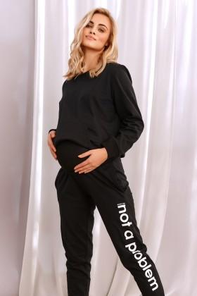 Czarne dresowe spodnie dla kobiet w ciąży z napisem n.a.p